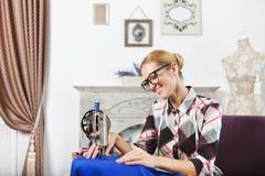 Vintage tailor dressmaker in her studio Stock Image
