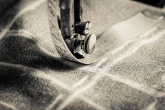 Vintage tailor machine with scissors, cloth and threads Royalty Free Stock Images