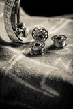Vintage tailor machine with threads, scissors and cloth Royalty Free Stock Image