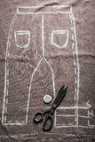 Vintage tailor pattern trousers with scissors and cloth. In tailor's workshop Royalty Free Illustration