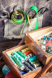 Vintage tailor's wooden box with needles, threads and buttons Royalty Free Stock Image