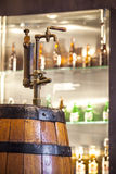 Vintage tap to barrel full of alcohol Royalty Free Stock Photo