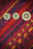 Vintage tape with embroidered ornaments and old buttons Stock Photos