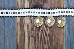 Vintage tape with embroidered pattern and three ancient buttons Stock Images