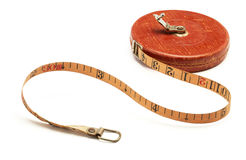 Vintage tape measure. Old-fashioned tape measure isolated on white background royalty free stock images