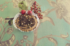 Vintage tasty muffin with chocolate and almond cakes Royalty Free Stock Images