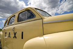 Vintage Taxi Cab in pale yellow Stock Images