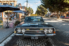A Vintage taxi in the main road of El Calafate in Santa Cruz Province, Argentina Royalty Free Stock Photo