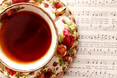Vintage Tea Cup with Music Royalty Free Stock Image