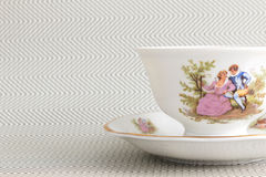 Vintage tea cup over background with  zigzags Royalty Free Stock Photography