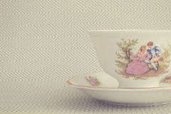 Vintage tea cup over background with zigzags Royalty Free Stock Photos