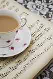 Vintage tea cup,saucer and Old Musical Sheets Royalty Free Stock Photo