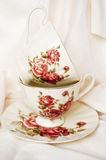 Vintage tea cups with roses Stock Image