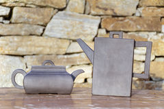 Vintage Tea kettles. On a stone background Royalty Free Stock Image