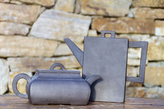 Vintage Tea kettles. On a stone background Stock Photo