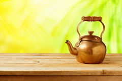 Vintage tea pot on wooden table Stock Images