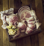 Vintage tea set in a crate Stock Photography