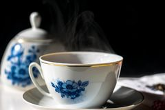 Vintage tea set with hot tea. China porcelain and steamy tea Royalty Free Stock Photo