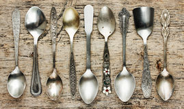 Vintage tea spoons collection on old wooden background Royalty Free Stock Photos