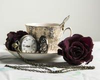 Vintage Tea Still Life 2. Vintage still life in color; rose, pocket watch, tea cup stock photos