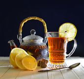 Vintage tea still life with lemon and sugar Royalty Free Stock Images