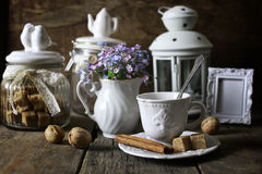 Vintage tea table concept. Various vintage elements on old worn backgrounds different concepts Royalty Free Stock Images
