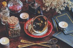 Free Vintage Teacup Laying On It`s Side On A Wiccan Witch Altar For Reading Tea Leaves As A Method Of Divination Royalty Free Stock Images - 192259429
