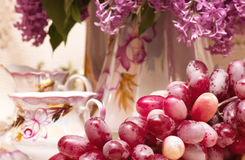 Vintage teacup with spring flowers. And grape Royalty Free Stock Photo