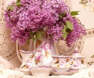 Vintage teacup. With spring flowers lilac Stock Photo
