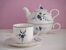 Vintage teacup and teapot with floral motif Stock Image