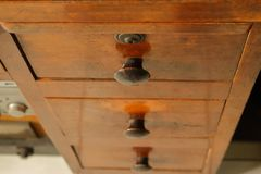 Vintage teak wood chest of drawers royalty free stock images