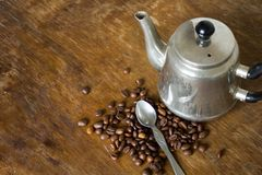 Vintage teapot coffee beans. On a wooden table Stock Photo