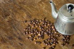 Vintage teapot coffee beans. On a wooden table Royalty Free Stock Photos