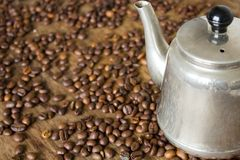 Vintage teapot coffee beans. On a wooden table Stock Images
