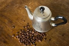 Vintage teapot coffee beans. On a wooden table Stock Photos
