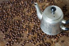 Vintage teapot coffee beans. On a wooden table Royalty Free Stock Image