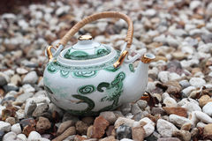 Vintage teapot on a stones Royalty Free Stock Photography