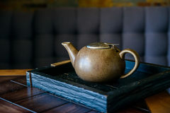 Vintage teapot on wooden board in restaurant Stock Image