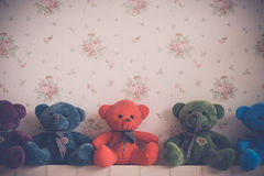 Vintage Teddy bear doll and sweet background Stock Photos