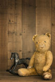 Vintage Teddy Bear and Rocking Horse Royalty Free Stock Images