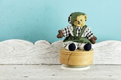 Vintage Teddy Bear toy alone on white wooden table. Royalty Free Stock Photography