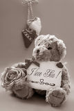 Vintage teddy bear with valentine`s greetings Royalty Free Stock Photography