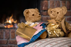 Vintage teddy bears  in front of fireplace Stock Image