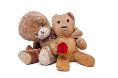 Vintage teddy bears in love. Romantic old couple on Valentines d. Ay. Cute pensioner stuffed toys clearly still loving each other, cuddling and holding a lovers Stock Images