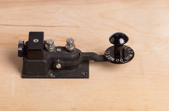 Vintage telegraph key on desk Stock Photography