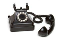 Vintage Telephone. Isolated old black vintage telephone Royalty Free Stock Images
