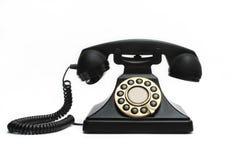 Vintage telephone. Vintage black telephone isolated on white background Stock Photos