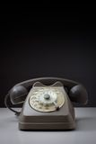 Vintage telephone. On a white surface and dark background Stock Photos