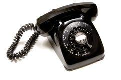 Vintage Telephone. Vintage, antique black desk telephone on white background Royalty Free Stock Images
