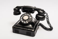 Vintage telephone. With rotary dial on a white backgrounf Royalty Free Stock Photo